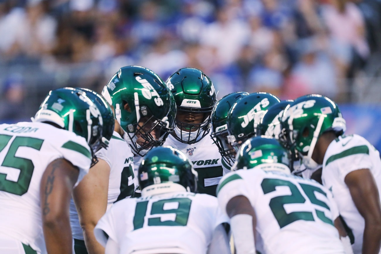 Tackle Eric Smith #65 of the New York Jets in the huddle against the New York Giants during their Preseason game at MetLife Stadium on August 08, 2019 in East Rutherford, New Jersey.