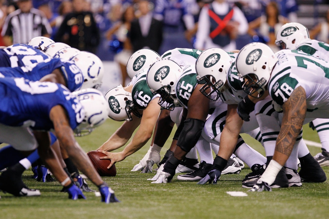 The New York Jets face off at the line of scrimmage against the Indianapolis Colts in the 2011 AFC Wild Card playoff at Lucas Oil Stadium on January 8, 2011 in Indianapolis, Indiana.