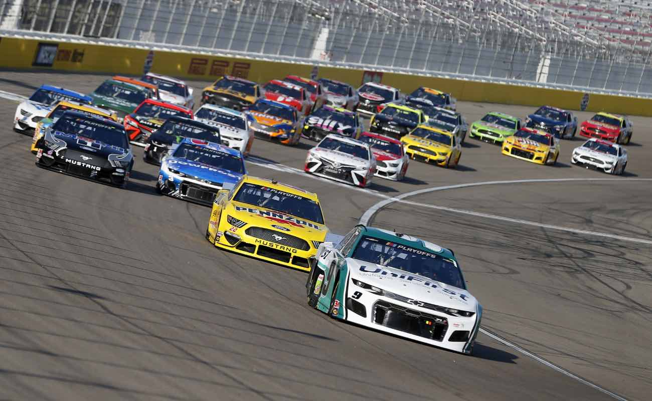 Chase Elliott, driver of the #9 Unifirst Chevrolet, leads the pack of cars during NASCAR Cup Series South Point 400 in September 2020