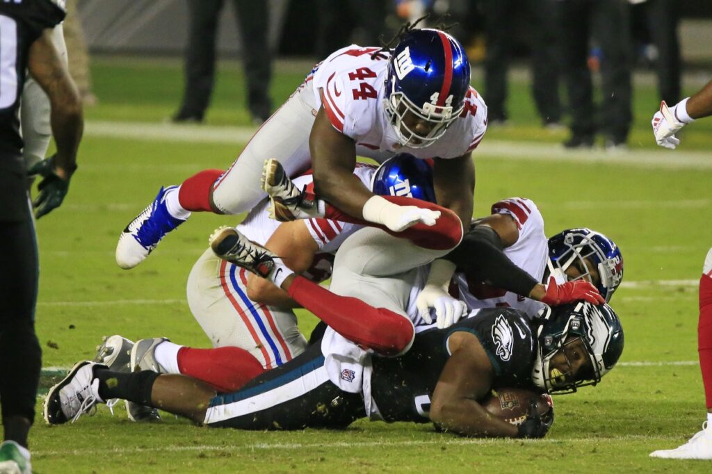 Boston Scott #35 of the Philadelphia Eagles is stopped by the New York Giants defense on a carry during the first quarter at Lincoln Financial Field on October 22, 2020 in Philadelphia, Pennsylvania.