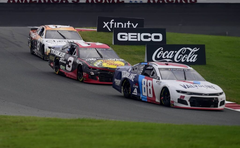 Alex Bowman, Austin Dillon, and Tyler Reddick, race during the NASCAR Cup Series Bank of America ROVAL 400 October 2020