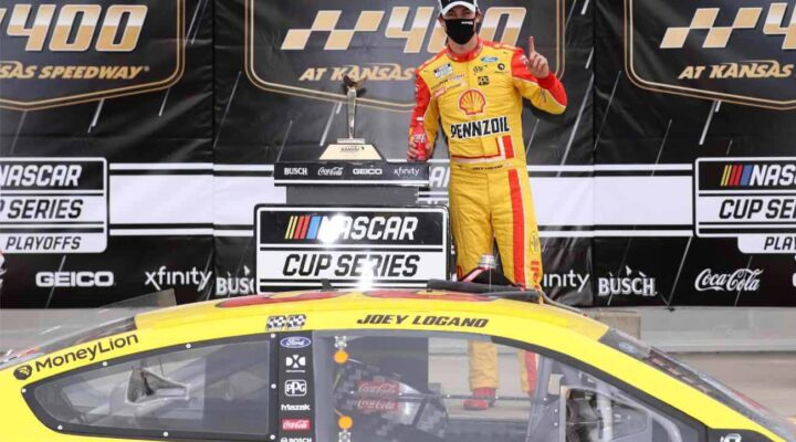 Joey Logano, driver of Shell Pennzoil Ford, celebrates after winning the NASCAR Cup Series Hollywood Casino 400 October 2020