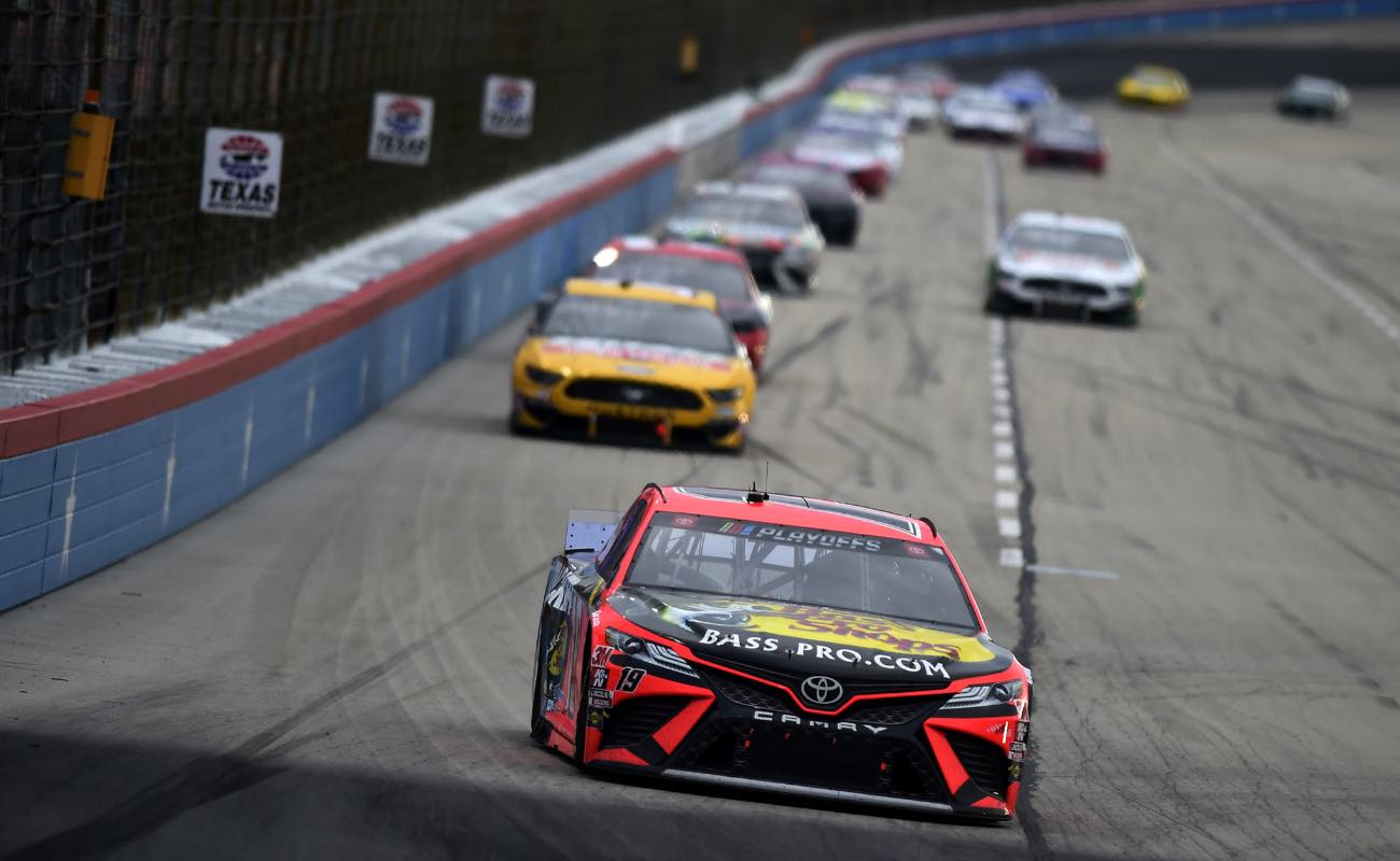 Martin Truex Jr., driver of the #19 Bass Pro Shops Toyota, leads the field at Texas Motor Speedway  October 2020.