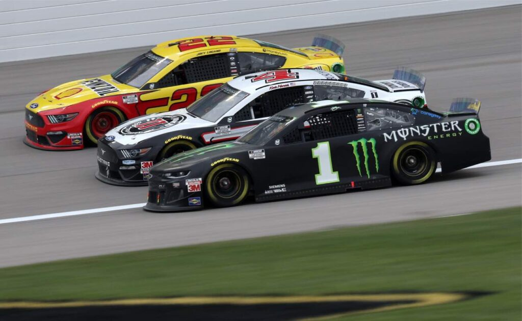 Kurt Busch, driver of the #1 Monster Energy Chevrolet, races Kevin Harvick, driver of the #4 Jimmy John's Ford, and Joey Logano, driver of the #22 Shell Pennzoil Ford October 2020.