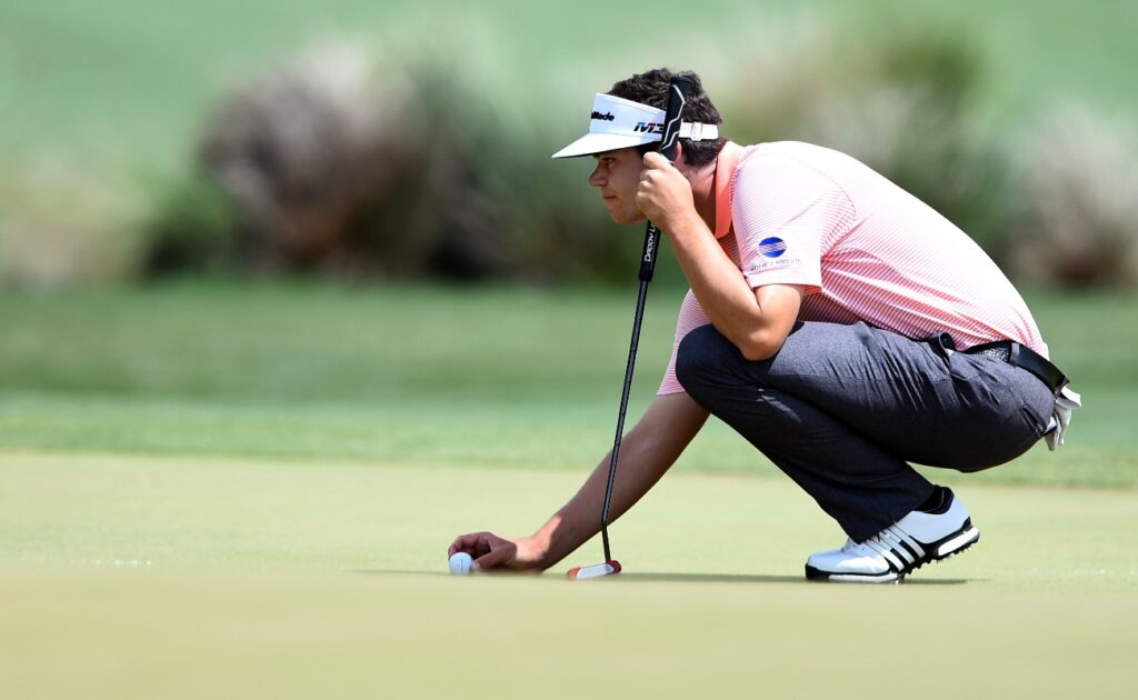 Beau Hossler lines up a putt on the second green during the final round of the Houston Open at the Golf Club of Houston on April 1, 2018 in Humble, Texas.