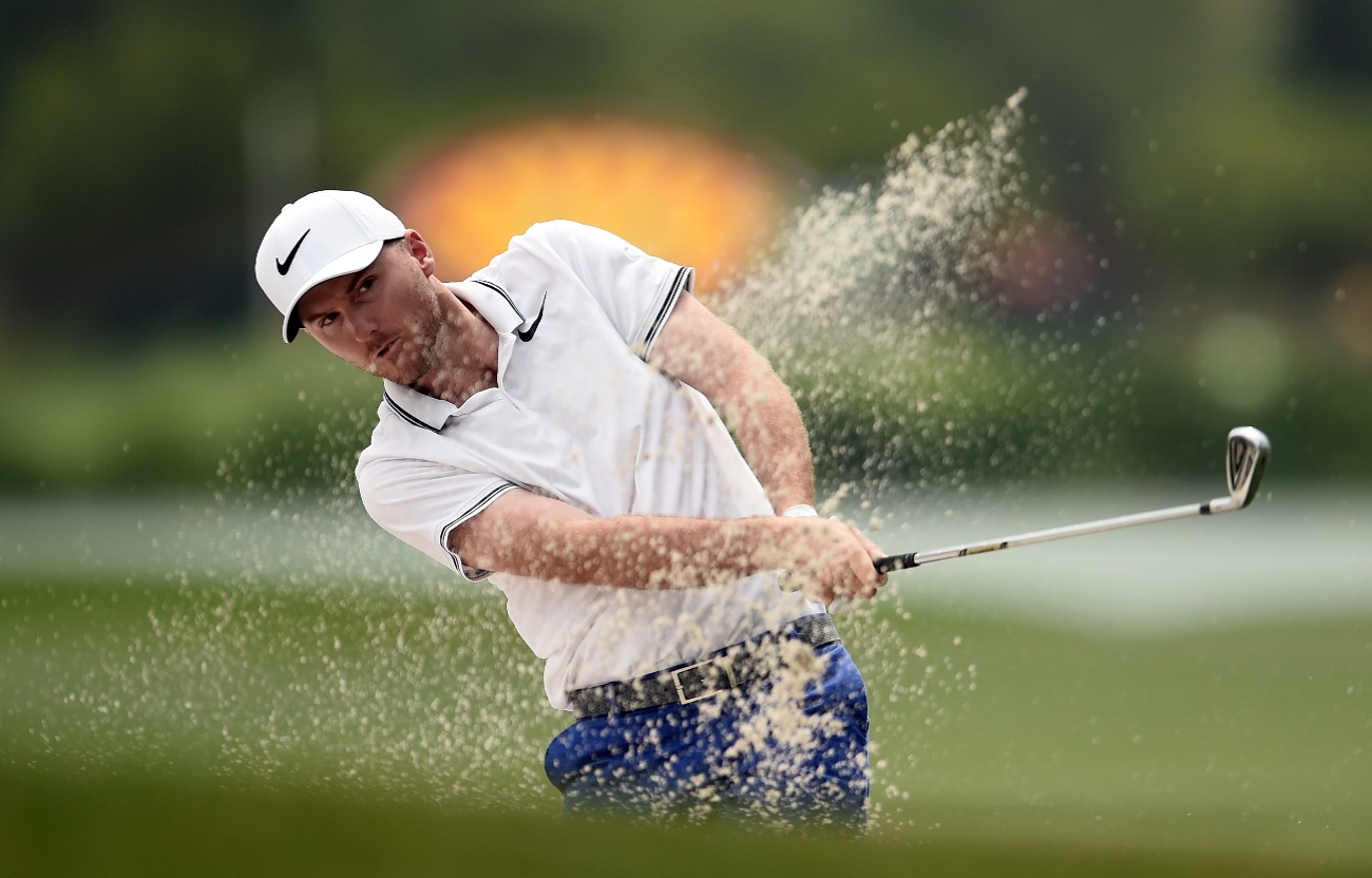 Russell Henley plays his second shot on the 18th hole during the final round of the Shell Houston Open at the Golf Club of Houston on April 2, 2017 in Humble, Texas