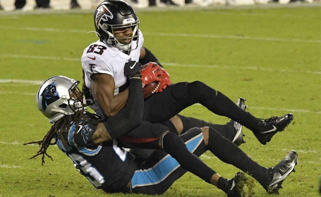 Stantley Thomas-Oliver of Carolina Panthers tackles Russell Gage of Atlanta Falcons at Bank of America Stadium October 2020.