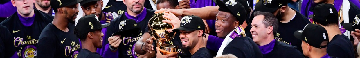 The Los Angeles Lakers celebrating and  holding the trophy after winning the 2020 NBA Championship October 2020