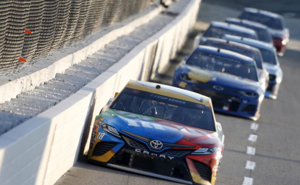 Kyle Busch, driver of the #18 M&M's Toyota, leading  during NASCAR Cup Series Xfinity 500 November 2020. Photo by Brian Lawdermilk/Getty Images