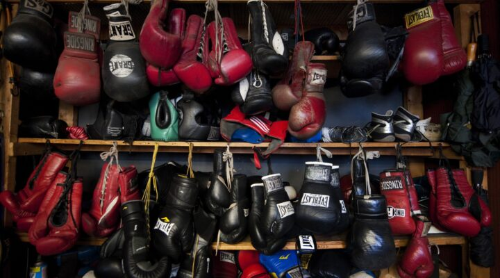 close up of assorted red and black boxing gloves