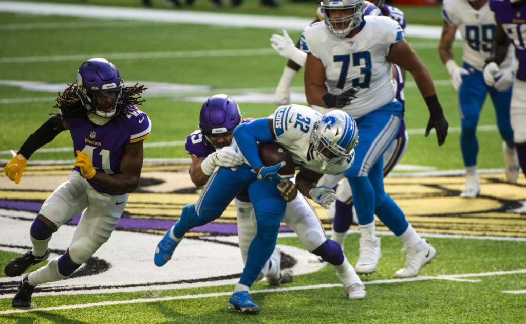 D'Andre Swift of Detroit Lions against the Minnesota Vikings at U.S. Bank Stadium November 2020. Photo by Stephen Maturen/Getty Images.