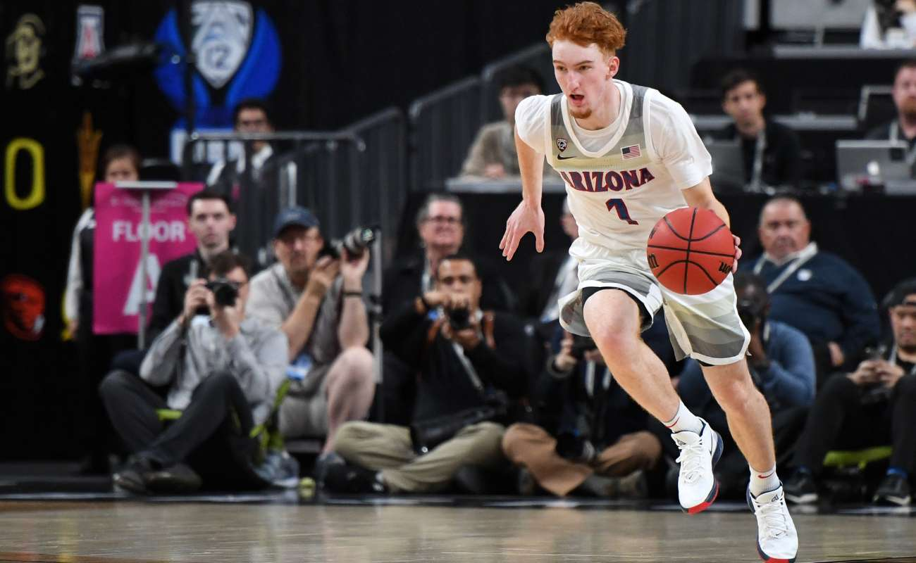 Nico Mannion brings the ball up the court. Ethan Miller/Getty Images
