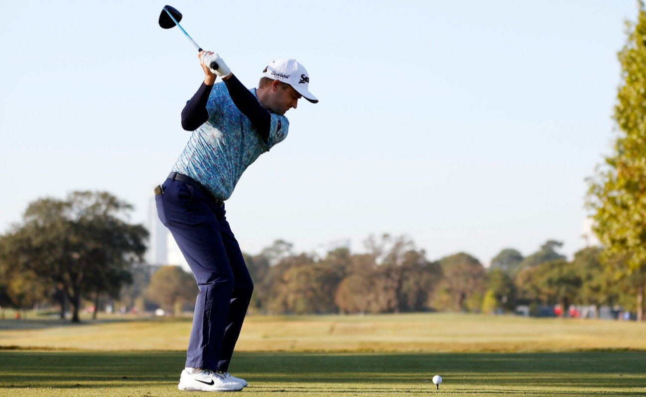 Russell Knox of Scotland plays his shot from the first tee during the third round of the Houston Open at Memorial Park Golf Course on November 07, 2020 in Houston, Texas.