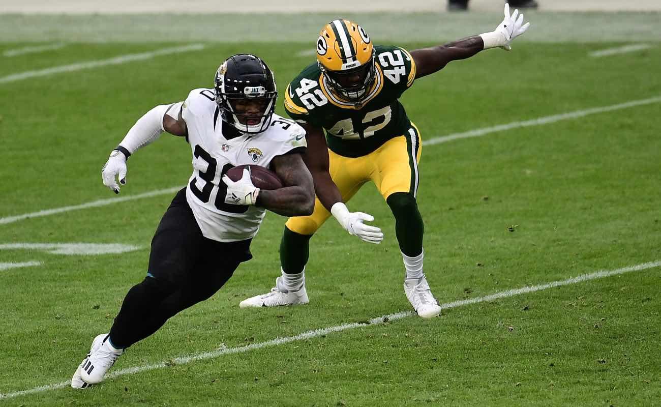 James Robinson ofJacksonville Jaguars against Oren Burks of Green Bay Packers at Lambeau Field November 2020.