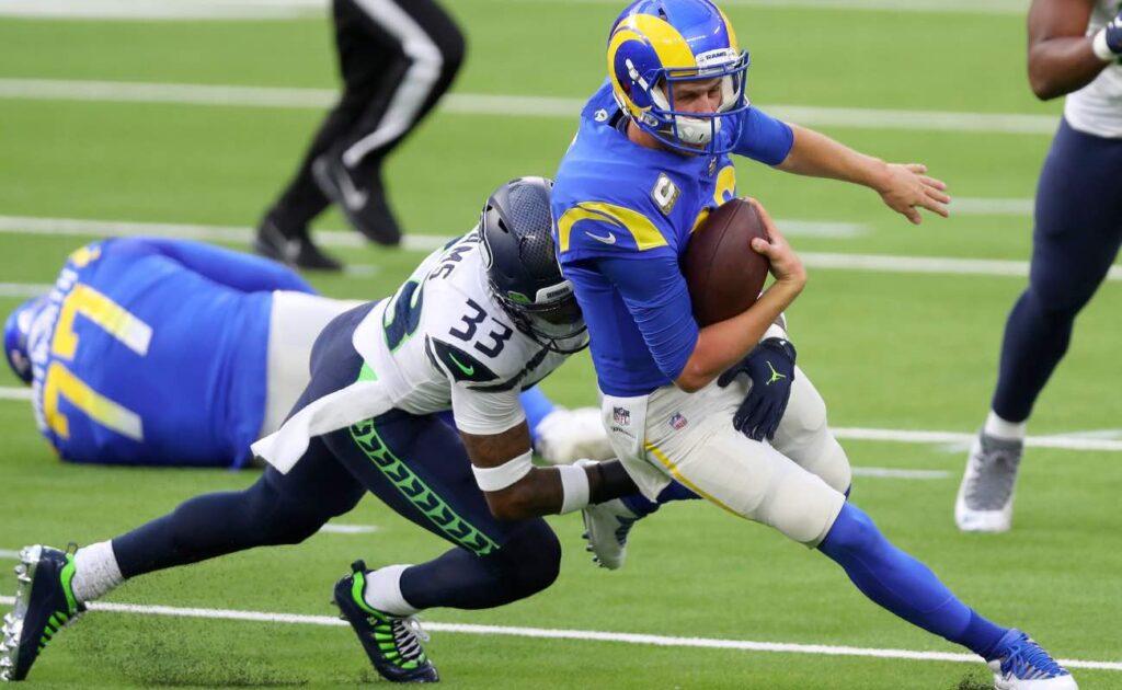 Jared Goff of Los Angeles Rams against Jamal Adams of Seattle Seahawks at SoFi Stadium November 2020.