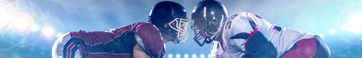 two college football players facing each other during night game