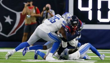Romeo Okwara #95 of the Detroit Lions forces Steven Mitchell #11 of the Houston Texans to fumble after a reception in the second quarter during a preseason game at NRG Stadium on August 17, 2019 in Houston, Texas.