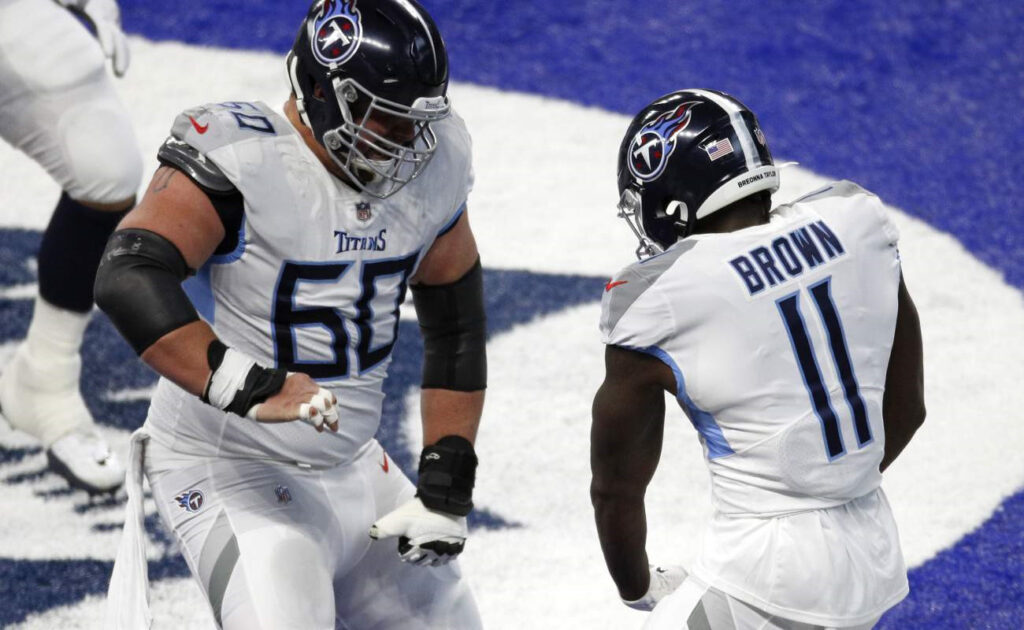 A.J. Brown and Ben Jones of the Tennessee Titans celebrate. Photo by Michael Hickey/Getty Images