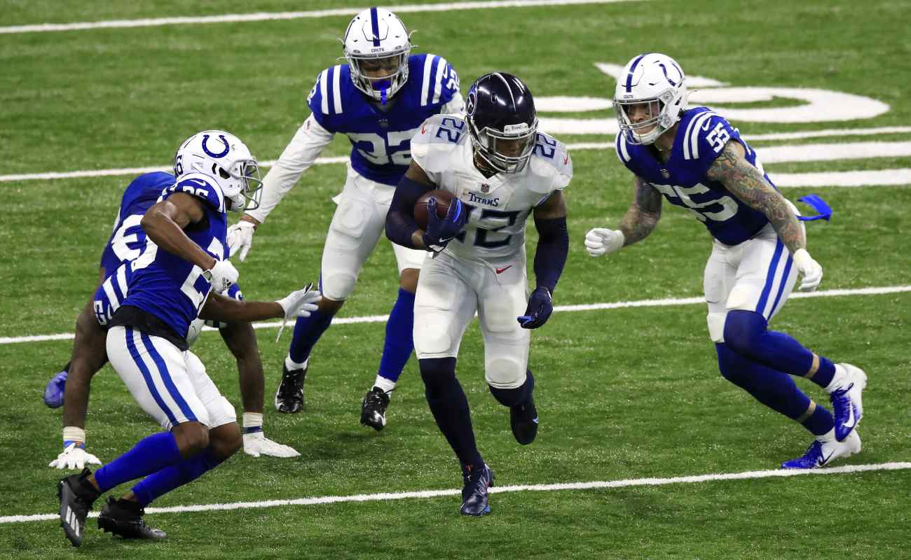 Tennessee Titans' player Derrick Henry surrounded by four Indiana Colts players. Photo by Andy Lyons/Getty Images