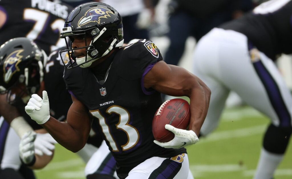 Devin Duvernay, wide receiver for the Baltimore Ravens, rushes with the ball. Photo by Patrick Smith/Getty Images