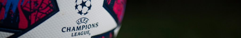 The Official Adidas Champions League Match Ball on a Green Background - Photo by VISIONHAUS