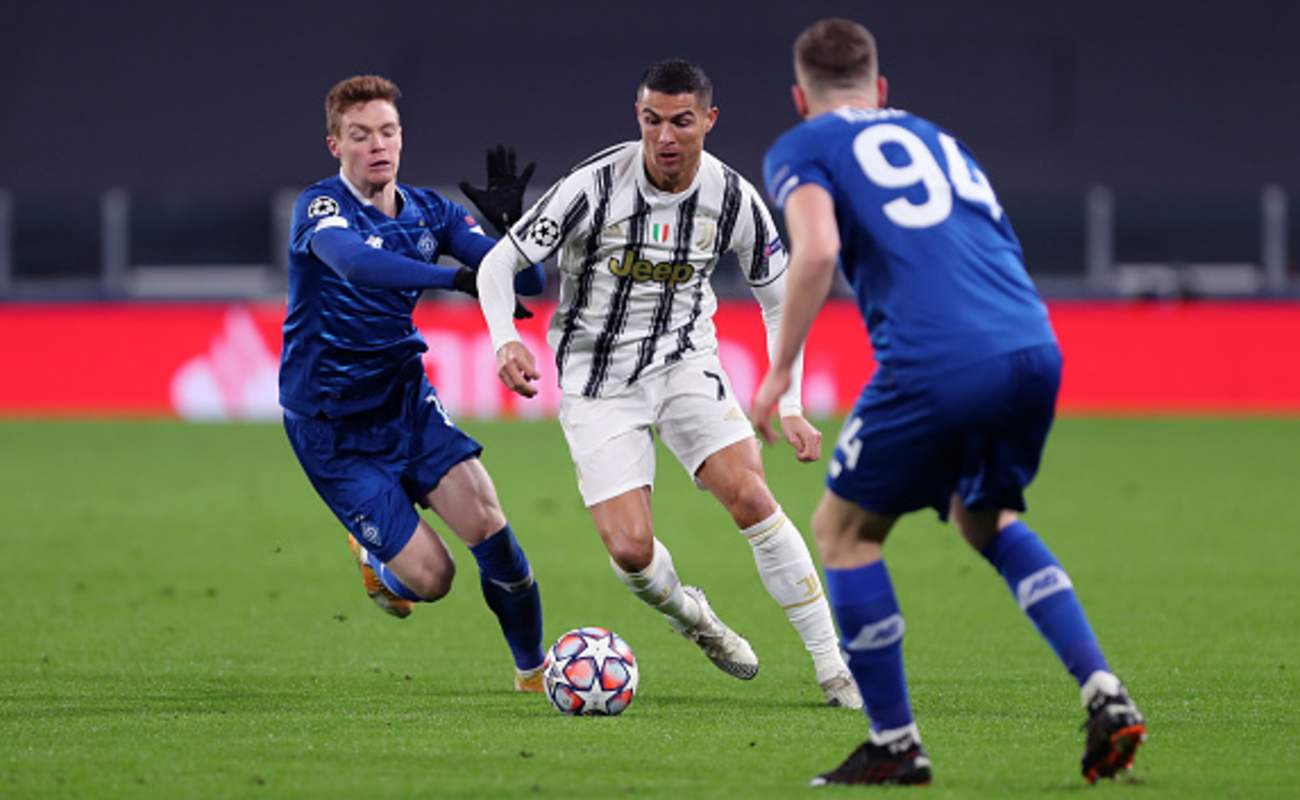 Cristiano Ronaldo of Juventus Dribbles Between Two Kyiv Players - Photo by SPORTINFOTO