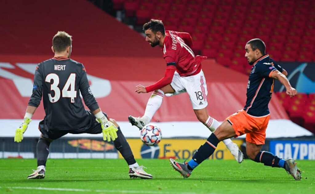 Bruno Fernandes of Manchester United Attempts to Control the Ball In Front of the Istanbul Basaksehir Goalkeeper - Photo by MICHAEL REGAN