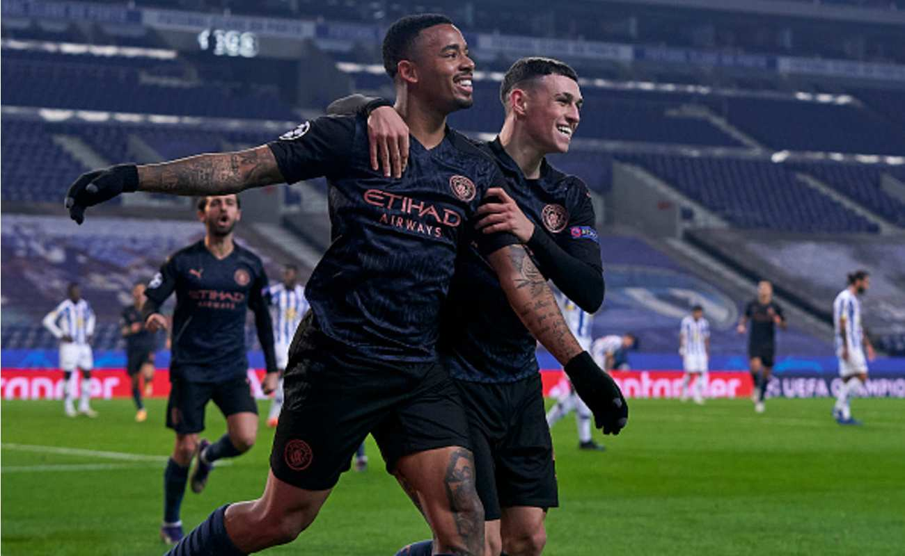 Gabriel Jesus and Phil Foden Celebrate After the Opening Goal Against Porto - Photo by JOSE MANUEL ALVAREZ