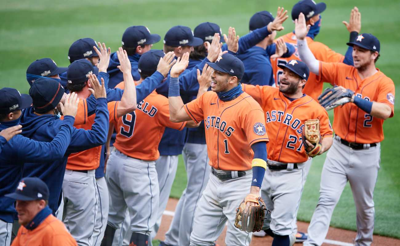 The Houston Astros celebrate a win. Photo by Hannah Foslien/Getty Images