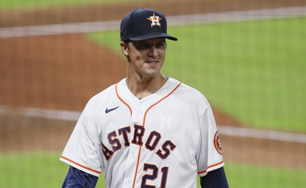 Zack Greinke of the Houston Astros walks to the dugout smiling. Photo by Bob Levey/Getty Images
