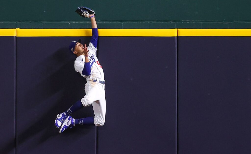 Los Angeles Dodgers' Mookie Betts catches a fly ball. Photo by Ronald Martinez/Getty Images