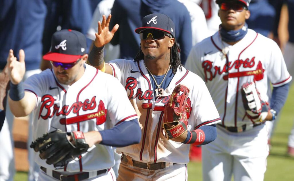 Atlanta Braves' Ronald Acuna Jr. with his team after a game. Photo by Todd Kirkland/Getty Images