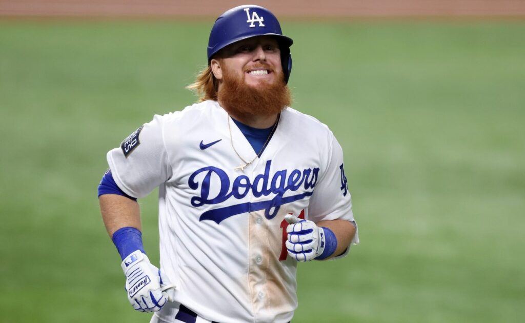 Los Angeles Dodgers' Justin Turner smiles as he runs. Photo by Tom Pennington/Getty Images