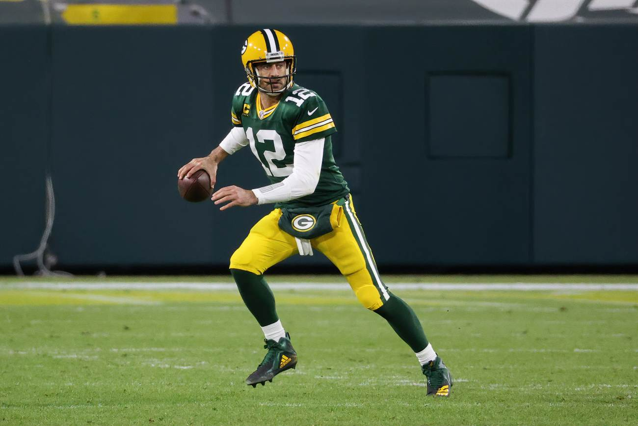 GREEN BAY, WISCONSIN - DECEMBER 06: Aaron Rodgers #12 of the Green Bay Packers drops back to pass in the third quarter against the Philadelphia Eagles at Lambeau Field on December 06, 2020 in Green Bay, Wisconsin. (Photo by Dylan Buell/Getty Images)