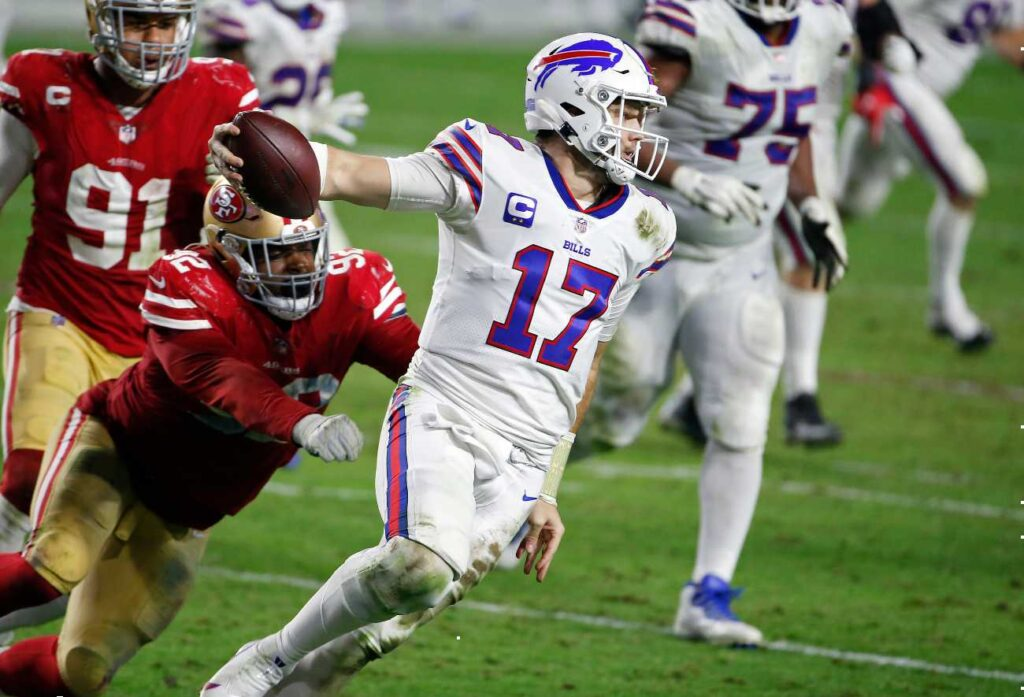 GLENDALE, ARIZONA - DECEMBER 07: Quarterback Josh Allen #17 of the Buffalo Bills scrambles to avoid a sack by defensive end Kerry Hyder Jr. #92 of the San Francisco 49ers during the second half of the NFL football game at State Farm Stadium on December 07, 2020 in Glendale, Arizona. (Photo by Ralph Freso/Getty Images)