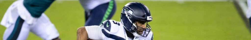 Russell Wilson #3 of the Seattle Seahawks runs the ball against the Philadelphia Eagles at Lincoln Financial Field on November 30, 2020 in Philadelphia, Pennsylvania. (Photo by Mitchell Leff/Getty Images)