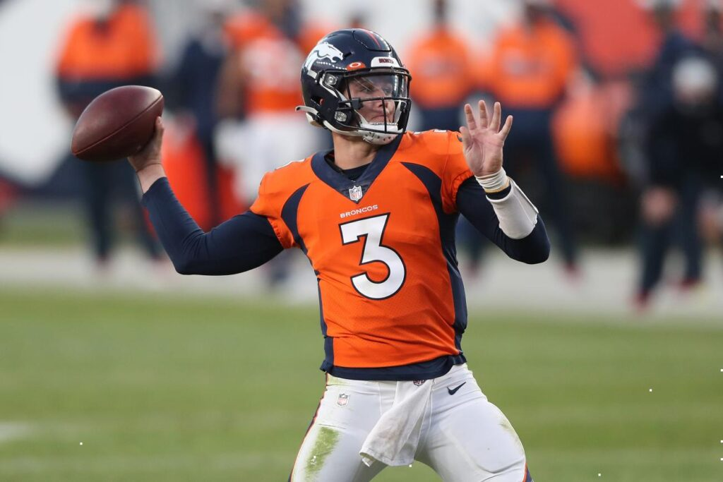 DENVER, COLORADO - NOVEMBER 01: Quarterback Drew Lock #3 of the Denver Broncos looks to throw for a touchdown against the Los Angeles Chargers in the fourth quarter of the game at Empower Field At Mile High on November 01, 2020 in Denver, Colorado. (Photo by Matthew Stockman/Getty Images)
