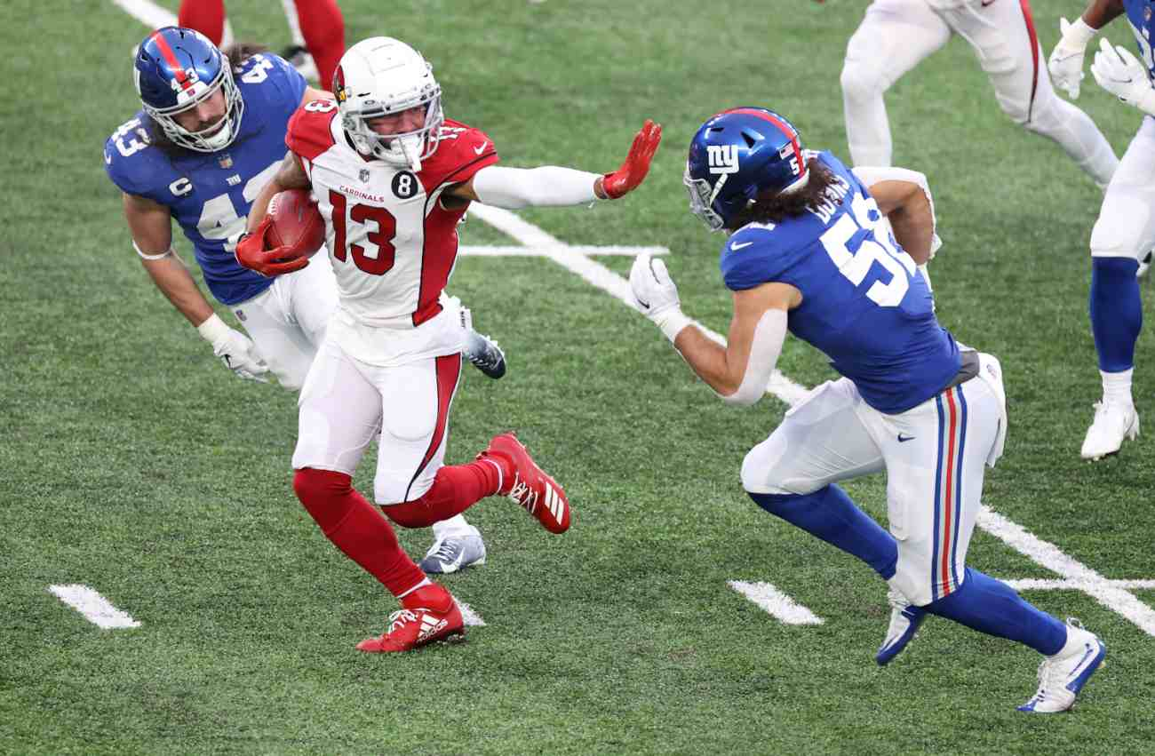 EAST RUTHERFORD, NEW JERSEY - DECEMBER 13: Wide receiver Christian Kirk #13 of the Arizona Cardinals holds out a straight arm as he runs with the ball against linebacker Devante Downs #52 of the New York Giants in the fourth quarter of the game at MetLife Stadium on December 13, 2020 in East Rutherford, New Jersey. (Photo by Al Bello/Getty Images)