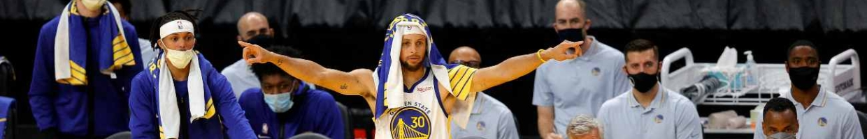 SAN FRANCISCO, CALIFORNIA - DECEMBER 12: Stephen Curry #30 of the Golden State Warriors reacts on the bench during their NBA preseason game against the Denver Nuggets at Chase Center on December 12, 2020 in San Francisco, California. NOTE TO USER: User expressly acknowledges and agrees that, by downloading and or using this photograph, User is consenting to the terms and conditions of the Getty Images License Agreement. (Photo by Ezra Shaw/Getty Images)