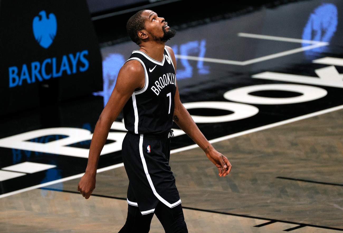 NEW YORK, NEW YORK - DECEMBER 13: Kevin Durant #7 of the Brooklyn Nets looks on during the first half against the Washington Wizards at Barclays Center on December 13, 2020 in the Brooklyn borough of New York City. NOTE TO USER: User expressly acknowledges and agrees that, by downloading and or using this photograph, User is consenting to the terms and conditions of the Getty Images License Agreement. (Photo by Sarah Stier/Getty Images)