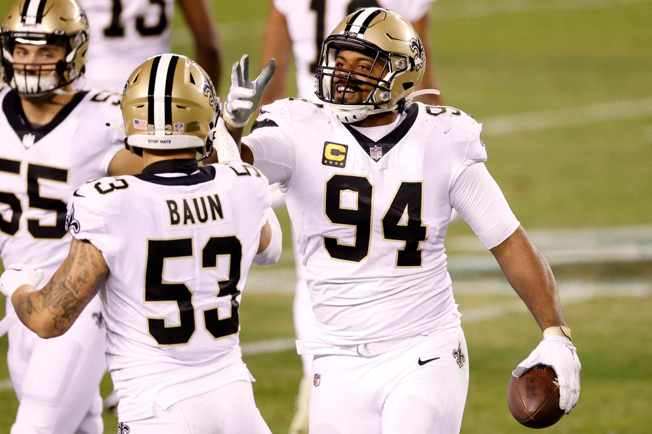 PHILADELPHIA, PENNSYLVANIA - DECEMBER 13: Cameron Jordan #94 of the New Orleans Saints celebrates a fumble recovery against the Philadelphia Eagles at Lincoln Financial Field on December 13, 2020 in Philadelphia, Pennsylvania. (Photo by Tim Nwachukwu/Getty Images)