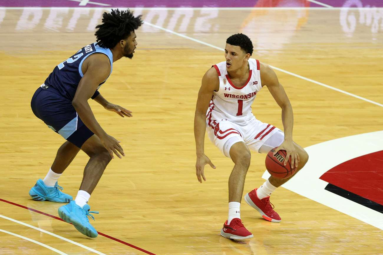 MADISON, WISCONSIN - DECEMBER 09: Jonathan Davis #1 of the Wisconsin Badgers is defended by Malik Martin #12 of the Rhode Island Rams during a game at Kohl Center on December 09, 2020 in Madison, Wisconsin. (Photo by Stacy Revere/Getty Images)