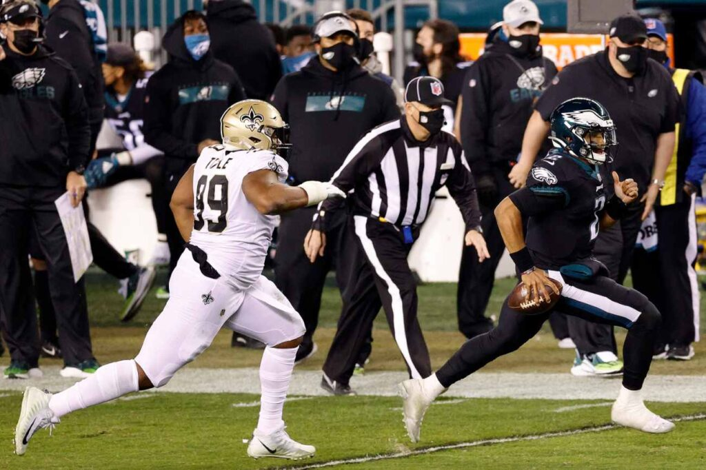 PHILADELPHIA, PENNSYLVANIA - DECEMBER 13: Jalen Hurts #2 of the Philadelphia Eagles rushes the ball past Shy Tuttle #99 of the New Orleans Saints at Lincoln Financial Field on December 13, 2020 in Philadelphia, Pennsylvania. (Photo by Tim Nwachukwu/Getty Images)