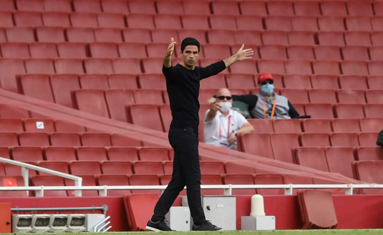 Mikel Arteta Holds His Hands Up in Frustration on the Sideline - Photo by Neil Hall / Getty Images