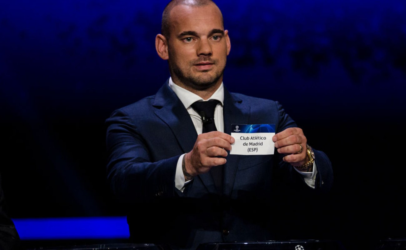 Dutch Soccer Legend Wesley Sneijder Holds Up a Card with Club Atlético Madrid On It - Photo by Eurasia Sport Images / Getty Images