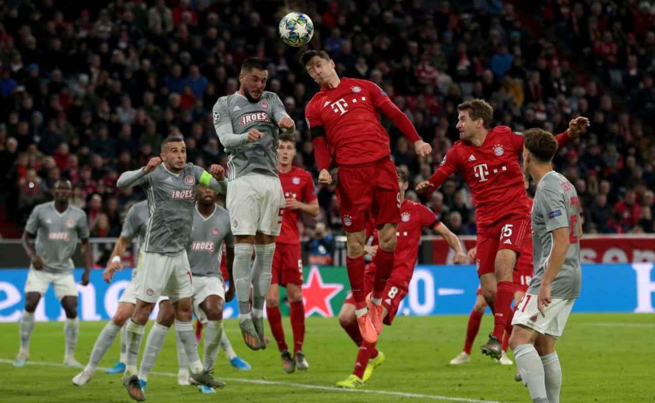 Robert Lewandowski of Bayern Munich Heads the Ball Towards Goal - Photo by TF-Images