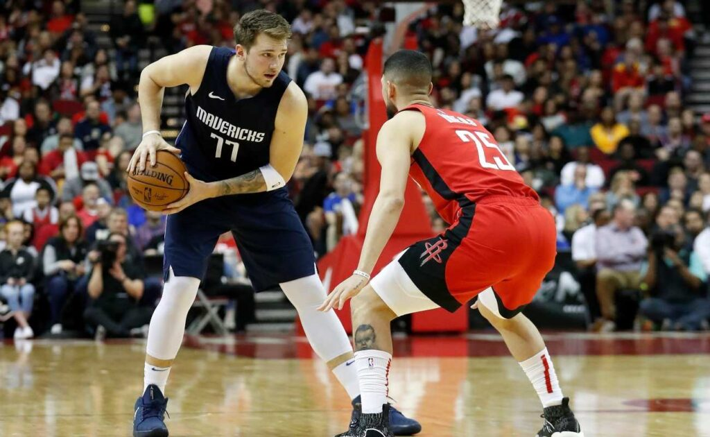 Luka Doncic #77 of the Dallas Mavericks controls the ball defended by Austin Rivers #25 of the Houston Rockets in the second half at Toyota Center on November 24, 2019 in Houston, Texas. (Photo by Tim Warner/Getty Images)