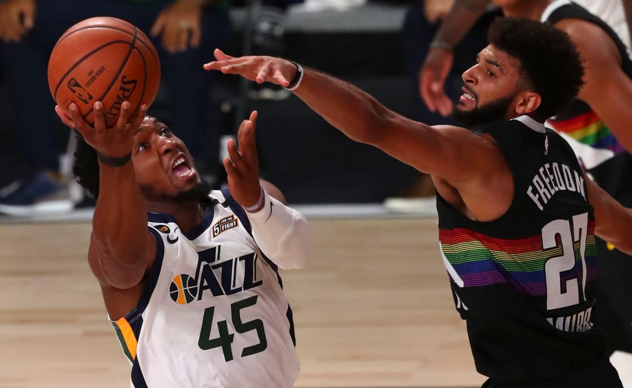 Donovan Mitchell #45 of the Utah Jazz shoots the basketball against Jamal Murray #27 of the Denver Nuggets during game two in the first round of the 2020 NBA Playoffs at AdventHealth Arena at the ESPN Wide World Of Sports Complex on August 19, 2020 in Lake Buena Vista, Florida. (Photo by Kim Klement-Pool/Getty Images)