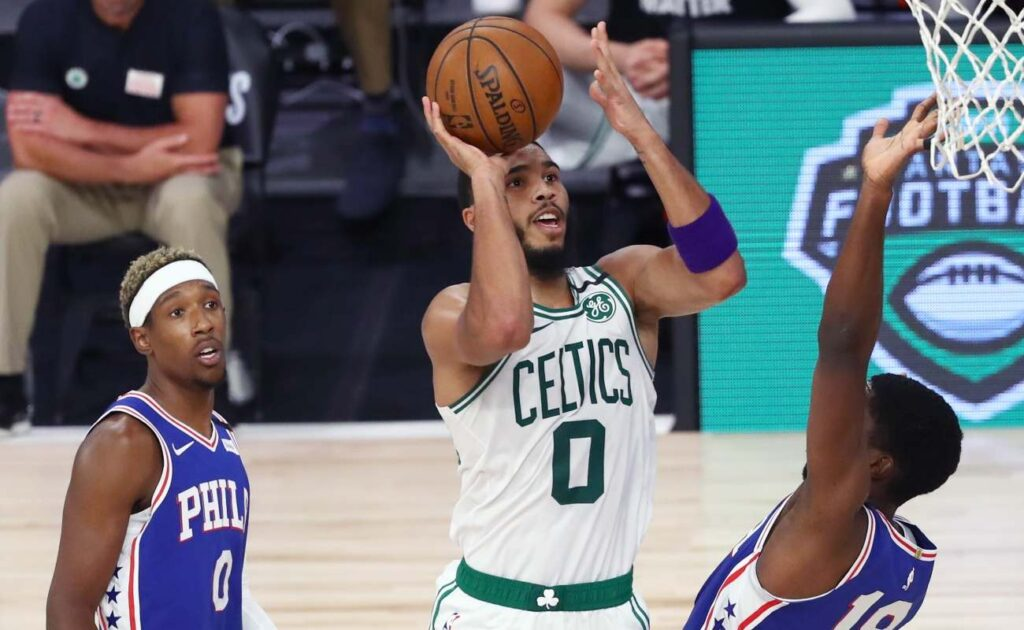 Jayson Tatum #0 of the Boston Celtics shoots over Shake Milton #18 of the Philadelphia 76ers during the second half in Game Four of the first round of the playoffs at The Field House at ESPN Wide World Of Sports Complex on August 23, 2020 in Lake Buena Vista, Florida. (Photo by Kim Klement-Pool/Getty Images)