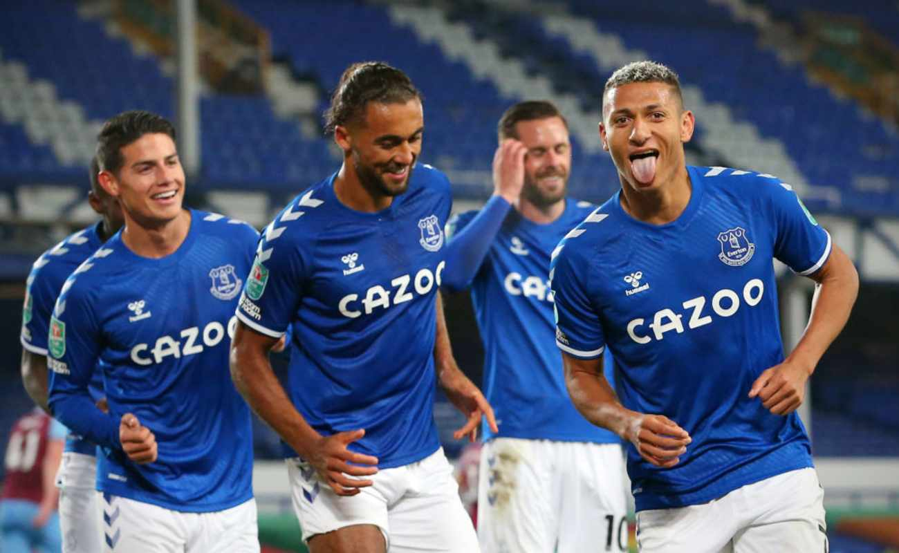 Everton's Richarlison Stick His Tongue Out In Celebration With His Teammates After Scoring a Goal - Photo by ALEX LIVESEY/Getty Images
